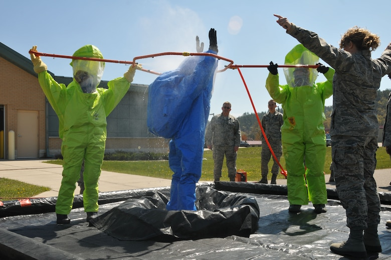 Airmen from the 148th Fighter Wing, Duluth, Minn., the 183rd FW, Springfield, Ill., and the 115th FW practice decontamination techniques and other emergency management skills at Volk Field Combat Readiness Training Center April 12-15. (U.S. Air Force photo by Senior Airman Ryan Roth)