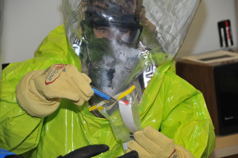 Tech. Sergeant Craig Akerstrom, 148th Fighter Wing, Duluth, Minn., emergency management, takes a sample of a chemical agent during an EM training exercise at Volk Field Combat Readiness Traing Center April 14.  He joined Airmen from the 115th FW, Madison, Wis., and the 183rd FW, Springfield, Ill., as the EM unit members trained together for the first time. (U.S. Air Force photo by Senior Airman Ryan Roth)