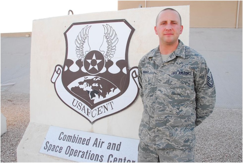Master Sgt. Robert E. Bailey poses for a picture during a seven-month deployment in 2011 and 2012 to the Combined Air and Space Operations Center in Southwest Asia where he served as the Superintendent of the Targeting and Imagery Support Element. While deployed, Bailey was recognized for his excellence and selected to be the SNCO of the Year for the state of Connecticut. (Photo courtesy of Master Sgt. Robert Bailey)