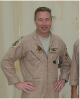 Lt. Col. John M. Girnius poses for a picture while deployed to the Combined Air and Space Operations Center in Southwest Asia, serving as the Chief, Combat Operations, and supervising more than 120 U.S. and Coalition forces. Lt. Col. Girnius' deployment in March 2012 marks the 100th individual deployment milestone for the 103rd Air Operations  Group, Bradley Air National Guard Base, East Granby, Conn.  (Photo courtesy of Lt. Col. John M. Girnius)