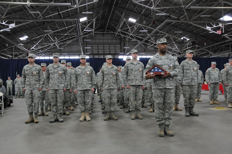 Col. Christopher Walker of the 103rd Air Operations Group stands as Commander of Troops with fellow Connecticut Air National Guardsmen during a formal Joint Freedom Salute Ceremony in the main hangar at Bradley Air National Guard Base in East Granby, Conn. March 31, 2012. Airmen and Soldiers of the Connecticut National Guard were formally welcomed home and honored following deployments over the past year. (U.S. Air Force photo by Tech. Sgt. Erin McNamara\RELEASED)