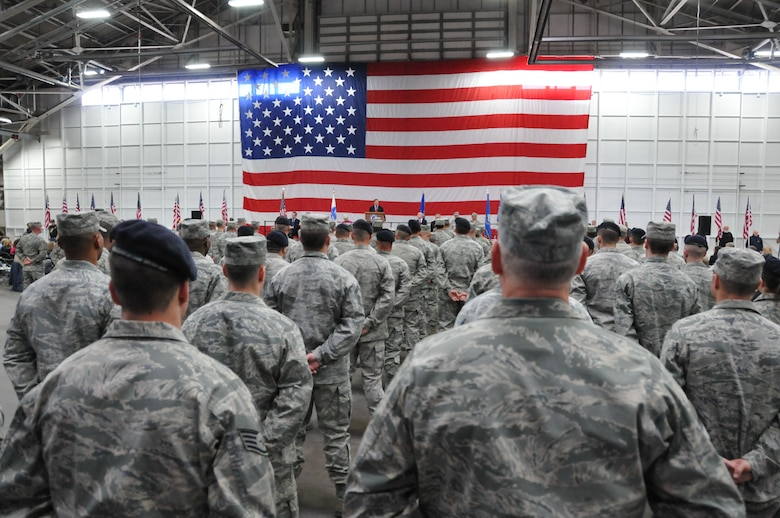 Airmen from the 103rd Civil Engineer Squadron, the 103rd Security Forces Squadron and the 103rd Air Operations Group stand at parade rest while Connecticut Governor Dannel P. Malloy addresses them along with Army National Guardsmen during a Joint Freedom Salute Ceremony in the main hangar at Bradley Air National Guard Base in East Granby, Conn. March 31, 2012. Airmen and Soldiers of the Connecticut National Guard were formally welcomed home and honored following deployments over the past year. (U.S. Air Force photo by Tech. Sgt. Erin McNamara\RELEASED)