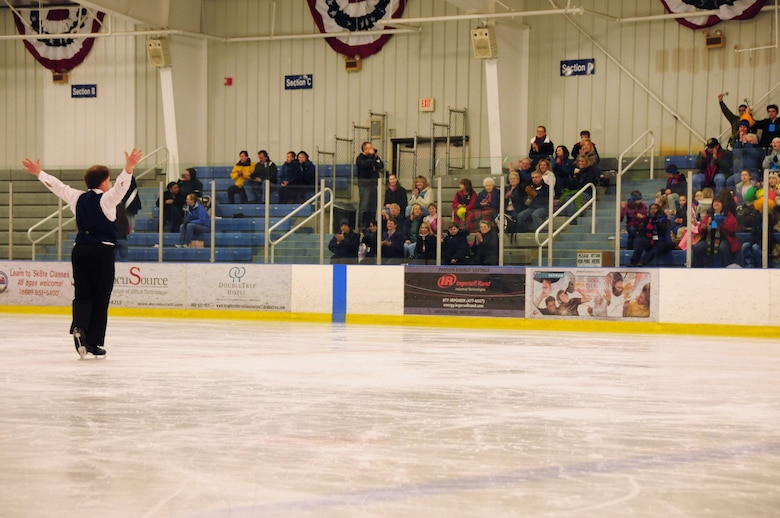 Michael Finlay of Boston Mass., welcomes applause from the crowd during the Special Olympics March 4, 2012. Finlay was one of many athletes who took part in the figure skating event at the international skating center in Simsbury, Conn. Several members of the Connecticut Air National Guard volunteered to help staff the event. (U.S. Air Force photo by Airmen 1st Class Emmanuel Santi-ago/Released)
