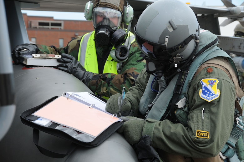 Members of the 148th Fighter Wing participate in an Operational Readiness Exercise June 11, 2011. The exercise was designed to refamiliarize Airmen with Force Protection Conditions, Mission Oriented Protection Postures and for members to perform the mission while wearing the Chemical Protective Overgarment. (U.S. Air Force photo by Senior Airman Sarah Hayes.)