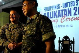 Brig. Gen. Frederick M. Padilla, Balikatan 2012 exercise director for U.S. forces, and Philippine Navy Rear Adm. Victor Emmanuel C. Martir, Philippine exercise director, stand shoulder to shoulder, displaying the partnership of their respective countries April 16 at Camp Aguinaldo, Philippines. Balikatan 2012 is the twenty-eighth iteration of the annual exercise and the third humanitarian assistance/disaster response focused exercise for the Philippines and the U.S. Padilla is the 3rd Marine Division commanding general, Okinawa, Japan.