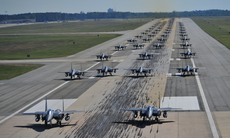 "F-15E Strike Eagles of the 4th Fighter Wing perform an ""Elephant Walk"" as they taxi down the runway during a Turkey Shoot training mission on Seymour Johnson Air Force Base, N.C., April 16, 2012. The wing generated nearly 70 aircraft to destroy more than 1,000 targets on bombing ranges across the state to commemorate the 4th's victory over the Luftwaffe on April 16, 1945. The aircrews are assigned to the 4th Fighter Wing's 333rd, 334th, 335th, and 336th Fighter Squadrons.  (U.S. Air Force photo/Staff Sgt. Elizabeth Rissmiller/Released)"