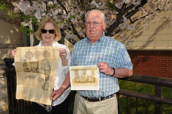 Dr. and Mrs. Seward hold a copy of The Tennessean from 1923 and a photo of Lieutenant J.A. Seward when he was with the 105th Squadron in the 1920s.