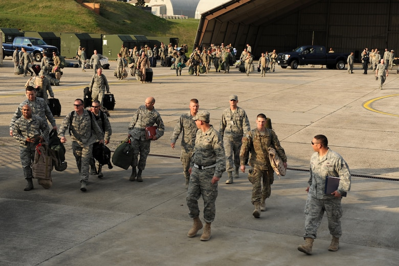 SPANGDAHLEM AIR BASE, Germany – Airmen from the 52nd Fighter Wing walk towards their friends and families after a customs inspection on Ramp 3 here April 13. Family and friends waited at Hangar 3 to welcome home more than 70 Airmen from a deployment with 81st Fighter Squadron to Bagram Airfield, Afghanistan, who had been providing close-air support during Operation Enduring Freedom. (U.S. Air Force photo by Airman 1st Class Matthew B. Fredericks/Released)