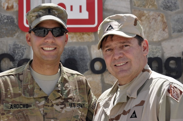 KANDAHAR AIRFIELD, Afghanistan — Julio (right), and 1st Lt. Francisco Arocho, father and son, reunite here, April 15, 2012. Both are currently deployed to Afghanistan; Julio with the U.S. Army Corps of Engineers and Francisco with the 668th Engineer Company from Orangeburg, N.Y