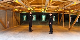 TBLISI, Republic of Georgia — Capt. Besik Galuashvili and Lt. Oniari Gia, instructors at the Tbilisi Police Academy, await cadets to arrive in the 554 square-meter range. The range has movable targets, a modular bullet trap and containment system that allow the bullet casings to be recycled.