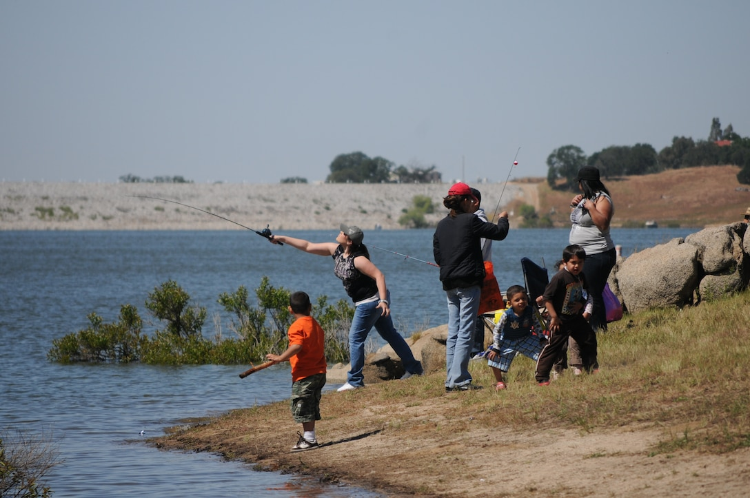 Families enjoy a day of fishing at the lake during the 15th annual Kids Fishing Day.
