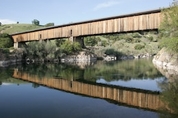 The Knights Ferry covered bridge is a scenic focal point at Stanislaus River Parks.