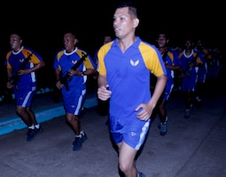 Lt. Christian Castillo runs with his airmen from Security Forces Squadron, Philippine Air Force (PAF), during Exercise Balikatan 2012 (BK12) at the Antonio Bautista Air Base April 17, 2012 in Puerto Princesa, Palawan, Republic of the Philippines. The squadron conducted physical fitness with a group of U.S. sailors from Marine Wing Support Group 17 (MWSG-17). BK12, in its 28th iteration, is an annual bilateral training exercise between the Republic of the Philippines and U.S. military members designed to build joint planning, contingency, humanitarian and disaster relief capabilities. Castillo is the squadron's commander. MWSG-17 is part of 1st Marine Aircraft Wing, III Marine Expeditionary Force.