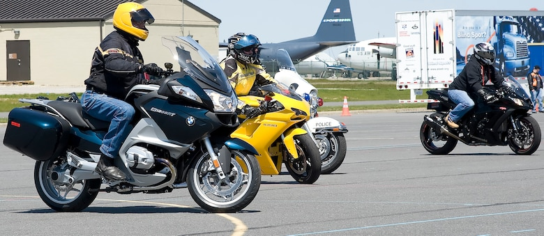 Team Dover members participate in a slow-drag competition during April 13, 2012, during Motorcycle Safety Day, at Dover Air Force Base, Del. Motorcycle Safety Day is a yearly event held to ensure riders and motorists are aware of increased safety measures while riding. (U.S. Air Force photo by Adrian R. Rowan)