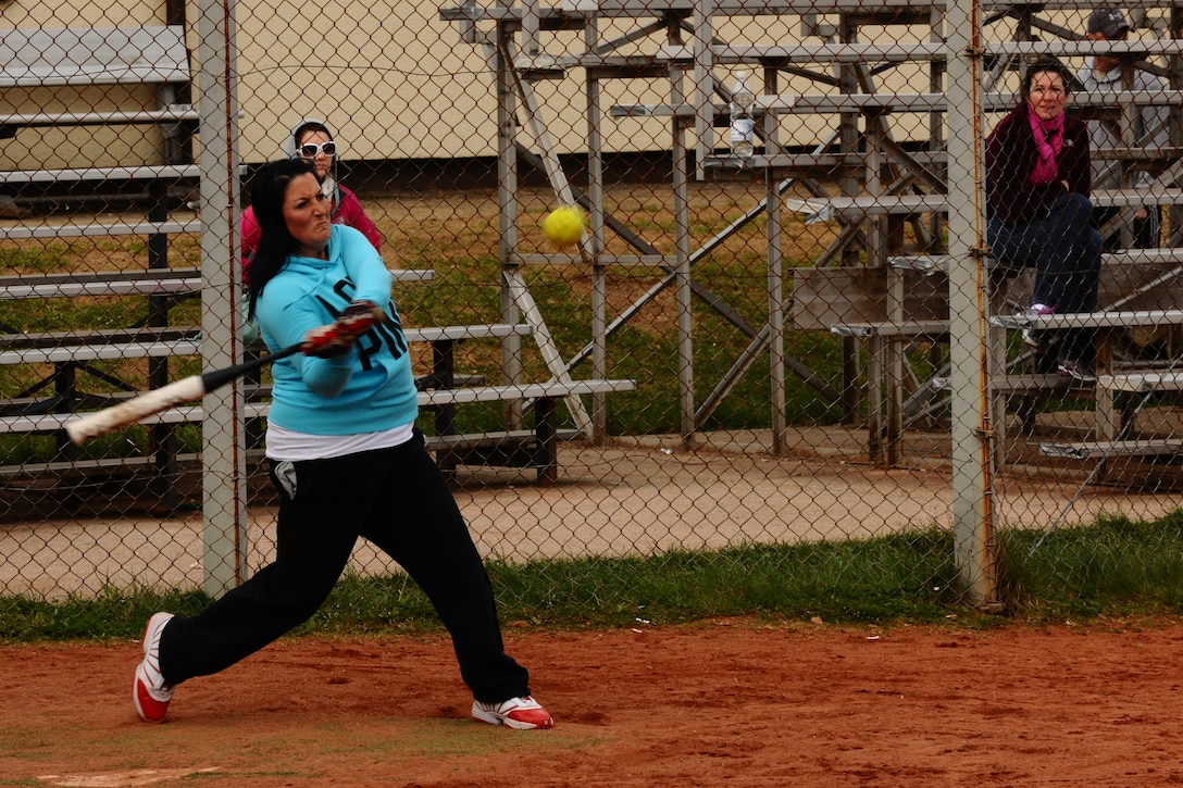 SPANGDAHLEM AIR BASE, Germany – Andrea Tuggle, wife of Garrett Tuggle, 52nd Civil Engineer Squadron, swings at a softball during a tournament on Field 1 here April 15. The first 52nd Maintenance Operations Squadron sponsored softball tournament included more than 12 teams made up of military and family members 18 and older and is intended to prepare players for the upcoming intramural season. The 52nd Civil Engineer Squadron team beat the 470th Air Base Squadron 19-17 in the final game of the double-elimination tournament. (U.S. Air Force photo by Airman 1st Class Dillon Davis/Released)