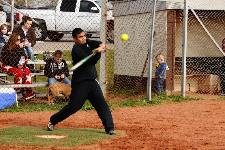 SPANGDAHLEM AIR BASE, Germany – Carlito Tacbas, 52nd Civil Engineer Squadron, swings at a softball during a softball tournament on Field 2 here April 14. The first 52nd Maintenance Operations Squadron sponsored softball tournament included more than 12 teams made up of military and family members 18 and older and is intended to prepare players for the upcoming intramural season. The 52nd Civil Engineer Squadron team beat the 470th Air Base Squadron 19-17 in the final game of the double-elimination tournament. (U.S. Air Force photo by Airman 1st Class Dillon Davis/Released)