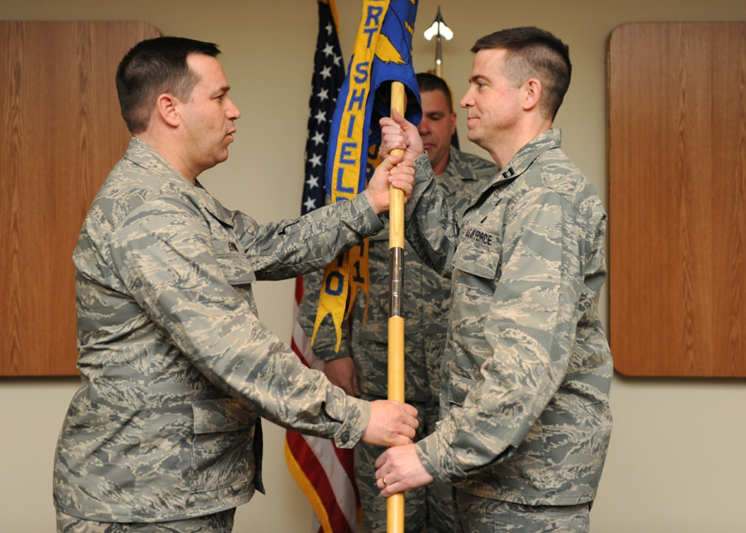 New York Air National Guard Capt. Christopher Deyo (right), incoming commander of the 174th Fighter Wing Security Forces Squadron, accepts the guidon from Col. Earl Evans, 174th Mission Support Group Commander, during an assumption of command ceremony held at Hancock Field Air National Guard Base on April 1, 2012.  Capt. Deyo was promoted to Major shortly thereafter. (Photo by NYANG Tech. Sgt. Ricky Best/RELEASED)