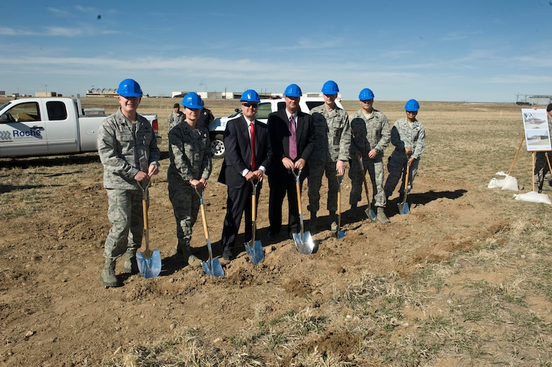 BUCKLEY AIR FORCE BASE, Colo -- Colonel Daniel Dant, 460th Space Wing commander, left, Col. Deirdre Mahon, 460th Mission Support Group commander, left, join the rest of the officiating party in the ground breaking of the new 460th Security Forces facility, Mar. 15, 2012. The new Security Forces Facility will be a two-story 35,175 square foot masonry building which will house all the base security operations including law enforcement, armory, base information and security functions. (U.S. Air Force photo by Airman 1st Class Riley Johnson)