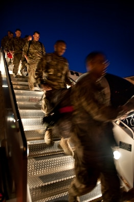 U.S. Air Force Airmen disembark from an aircraft on the flight line on Hurlburt Field, Fla., April 6, 2012. The members have been deployed in support of overseas contingency operations. (U.S. Air Force photo/Airman 1st Class Christopher Williams)(Released)