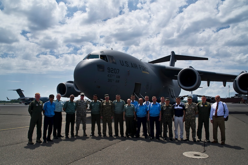 Delegates from the Tajikistan, Turkmenistan and Uzbekistan militaries pose for a picture after touring a C-17 Globemaster III at Joint Base Charleston - Air Base April 17. (U.S. Air Force photo by Airman 1st Class George Goslin)