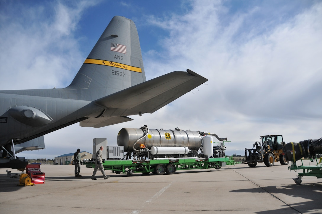 Airmen assigned to the 153rd Airlift Wing, Cheyenne, Wyo., prepare to load a U.S. Forest Service Modualar Airborne Firefighting System II onto a Wyoming Air National Guard C-130, April 13, 2012. The annual training maintains currency and upgrade qualifications for pilots, aircrew and ground crews in preparation for the fire season. (U.S. Air Force photo by 1st Lt. Rusty Ridley)