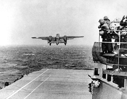 A B-25 thunders skyward off the deck of the USS Hornet. Around 600 miles from Japan mainland, a small fishing boat was spotted and destroyed by the Hornet and its crew. Lt. Col. James Doolittle felt this small boat may have warned Japan, so he ordered the raid to proceed immediately. (U.S. Air Force courtesy photo)