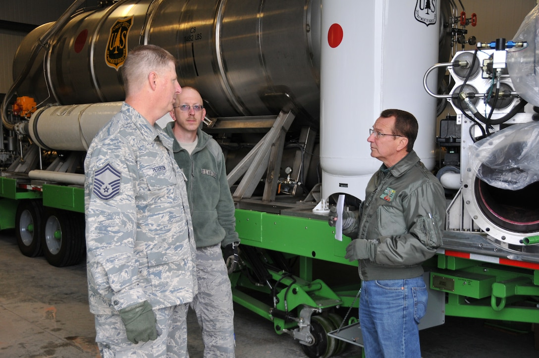 Senior Master Sgt. Douglas Peterson, 187th Airlfit Squadron loadmaster, and Master Sgt. Stephen Johnson, 153rd Logistics Readiness Squadron air transportation craftsman, speak with Bob Onsgard, U.S. Forest Service aviation management specialist, April 13, 2012, shortly before loading a Modualar Airborne Firefighting System II onto a Wyoming Air National Guard C-130. This annual training, conducted in Cheyenne, Wyo., maintains currency and upgrade qualifications for pilots, aircrew and ground crews in preparation for the fire season. (U.S. Air Force photo by 1st Lt. Rusty Ridley)