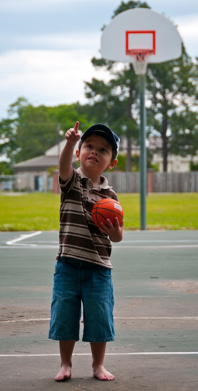 Three-year-old Hunter, son of Tricia and Staff Sgt. Justin Hoffman, 15th Airlift Squadron loadmaster, 437th Airlift Wing, plays basketball at a Joint Base Charleston –Air Base park April 14. Hunter is very coordinated for his age group and enjoys watching and playing hockey. Hunter was recently diagnosed with moderate to severe classical autism. He attends Applied Behavior Analysis therapy at school to counteract the symptoms of the disease. (U.S. Air Force photo by Airman 1st Class Dennis Sloan)