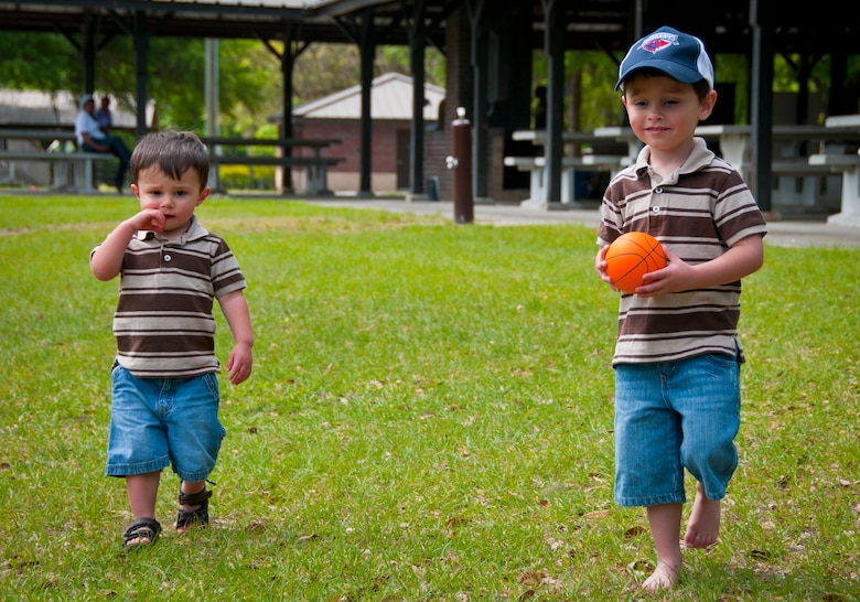 Three-year-old Hunter, son of Tricia and Staff Sgt. Justin Hoffman, 15th Airlift Squadron loadmaster, 437th Airlift Wing, heads to the basketball courts at a Joint Base Charleston – Air Base Park with his younger brother Cage not too far behind April 14. Hunter was recently diagnosed with moderate to severe classical autism and receives Applied Behavior Analysis therapy to help counteract the symptoms of the disease. He enjoys playing sports and especially hockey. (U.S. Air Force photo by Airman 1st Class Dennis Sloan/Released)