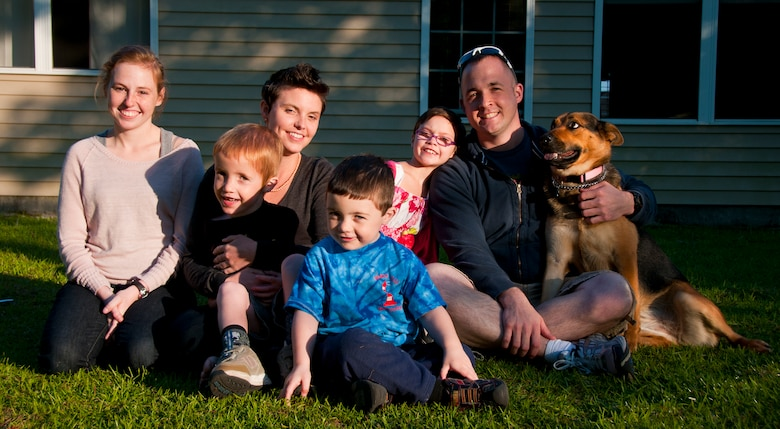 The Sole family has one daughter and two sons. All three are enrolled in the base exceptional family member program. Eight-year-old Xander (back row third from left) has Attention Deficit Hyperactive Disorder as well as multiple learning disabilities. Carl has Autism Spectrum Disorder in addition to epilepsy, cerebral palsy and intellectual disabilities as a result of periventricular leukomalacia. The Sole's youngest child Phillip (center) has speech and fine motor delays. (U.S. Air Force photo by Airman 1st Class Dennis Sloan)