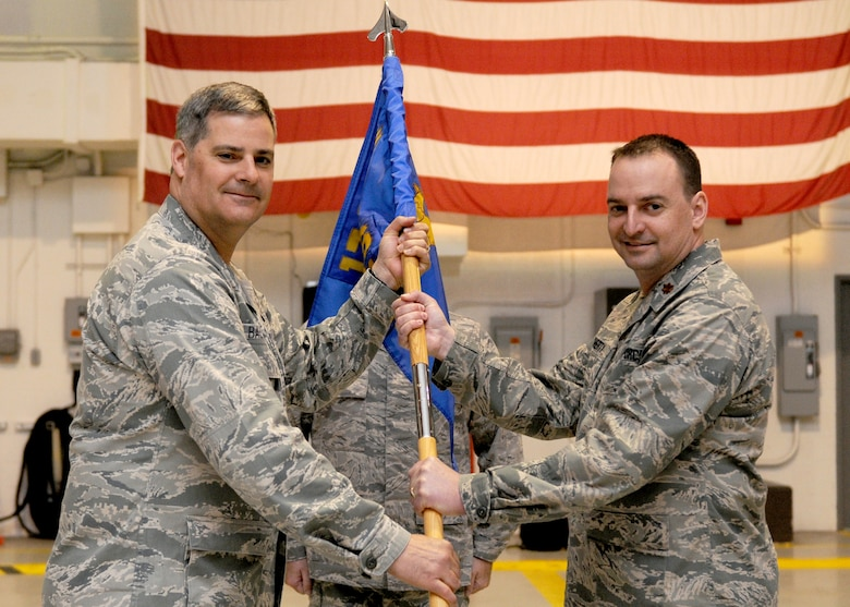 New York Air National Guard Col. John Balbierer (left), 174th Fighter Wing Maintenance Group Commander, presents the guidon to Maj. Matthew Dougherty who assumed command of the 174th Maintenance Squadron during a ceremony held at Hancock Field Air National Guard Base on 1 April 2012.  Maj. Dougherty takes over command from Lt. Col. John O'Conner. (Photo by Tech. Sgt. Ricky Best/RELEASED)