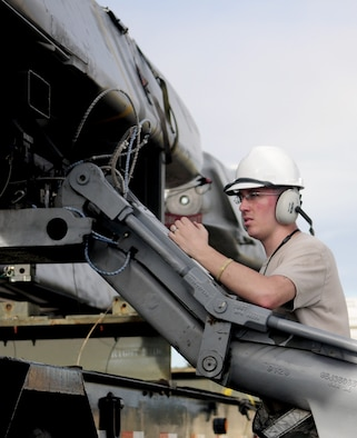 ANDERSEN AIR FORCE BASE, Guam- Staff Sgt. Zachary Neff, missile maintainer deployed from Barksdale Air Force Base, Loads a Conventional Air- Launched Cruise Missile during the Pre Combat Ammunition Production Exercise April 9. During the CAPEX approximately 100 inspectors will evaluate the processes and procedures for building munitions to support the wing's operational plan.  (U.S. Air Force photo by Senior Airman Jeffrey Schultze)
