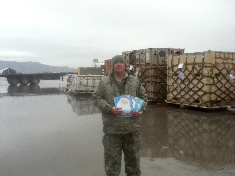 Tech Sgt. Timothy Hageny, an Airman assigned to the 167th Airlift Wing's Logistics Readiness Squadron, shows some letters he received from fifth-graders at Warm Springs Intermediate School in Berkeley Springs, W.Va. Fellow Airmen deployed from the 167th Airlift Wing assisted Hageny in responding to the letters.