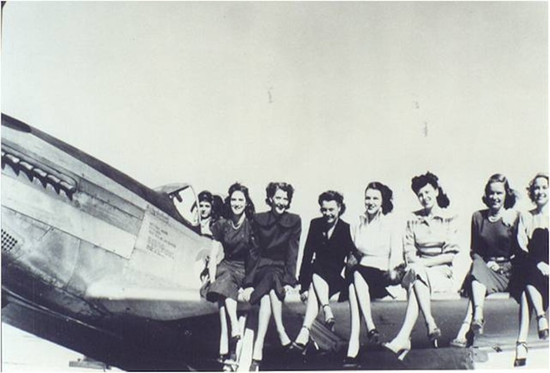 A group of stewardesses sit on a WyANG F-51D in the early days of stewardess training in Cheyenne, Wyo. (Photo courtesy of Michael Kassel)