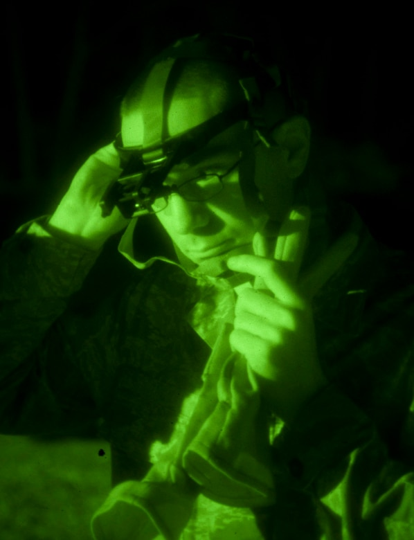 Senior Airman Christopher Church from the 208th Weather Flight of the Minnesota Air National Guard secures a night vision headset prior to beginning night vision training. Sixteen members of the 208th along with three U.S. Marines from the Marine Wing Support Squadron 471 US Naval- Marine Corps Reserve Readiness Center Minneapolis are taking part in a field training exercise at William O'Brien State Park on the St. Croix River in Minnesota Apr. 13, 2012. USAF photo by Tech. Sgt. Erik Gudmundson