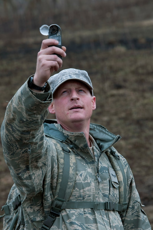 Technical Sergeant Craig Von Holton from the 208th Weather Flight of the Minnesota Air National Guard, uses a Kestral weather meter to obtain wind speed during a field training exercise at William O'Brien State Park Apr. 13, 2012. Sixteen members of the 208th along with three U.S. Marines from the Marine Wing Support Squadron 471 US Naval- Marine Corps Reserve Readiness Center Minneapolis are taking part in a field training exercise. USAF photo by Tech. Sgt. Erik Gudmundson