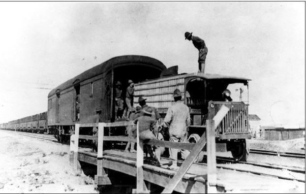 Members of the 1st Aero Squadron transfer a crated airplane from a rail car to truck in Columbus N.M., March 1916. (Contributed photo)