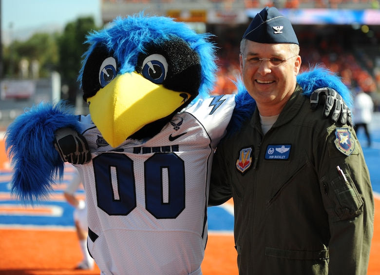 Col. Ron Buckley, 366th Fighter Wing commander, show his Air Force pride during the Air Force vs. Boise State University football game Oct. 22, 2012, in Boise, Idaho.  While he heads out to his new assignment he will always remain a Gunfighter! (U.S. Air Force photo/2nd Lt. David Liapis)