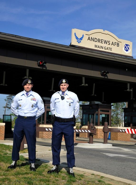 Elite Gate Guards Tech. Sgt. Scott Gero and Airman 1st Class Blake Miller pose in front of the Joint Base Andrews Main Gate April 16. Differences between Elite Gate Guards and Andrews' original gate guards include a revamped uniform and higher standards of performance. (U.S. Air Force Photo/Airman 1st Class Lindsey A. Porter)