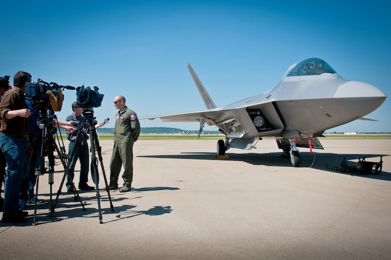 News reporters interview Maj. Henry Schantz, commander of the U.S. Air Force F-22 Raptor Demonstration Team, at the Kentucky Air National Guard Base in Louisville, Ky., on April 18, 2012. Schantz, who is based at Langley Air Force Base, Va., will be piloting the F-22 in Louisville's 22nd annual Thunder Over Louisville air show, to be held along the banks of the Ohio River on April 21. The Raptor is the U.S. military's premier fighter aircraft, with capabilities that are unmatched by any other plane. (U.S. Air Force Photo by Master Sgt.Phil Speck)