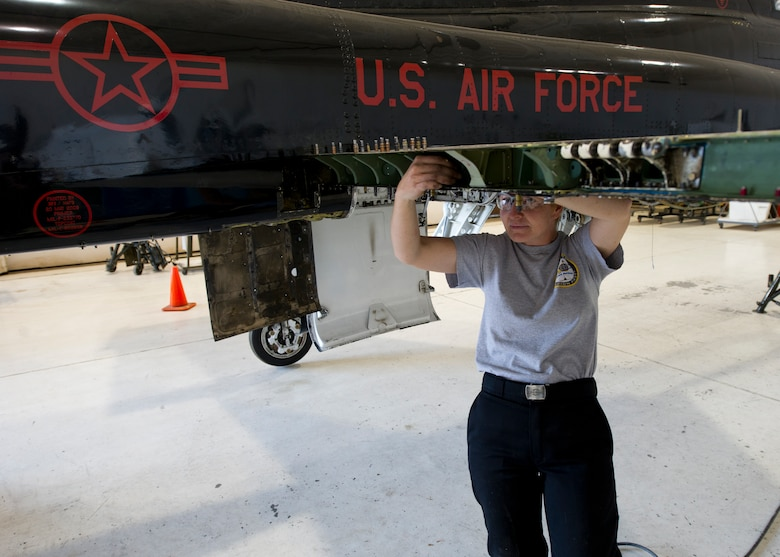 HOLLOMAN AIR FORCE BASE, N.M. – Tina McClane, an aircraft structural mechanic for the T-38 Talon, performs a spar replacement on a wing April 19. Small pieces of the aircraft such as the spar are constantly undergoing maintenance to ensure the aircrew can operate safely at all times. (U.S. Air Force photo by Daniel E. Liddicoet/Released)