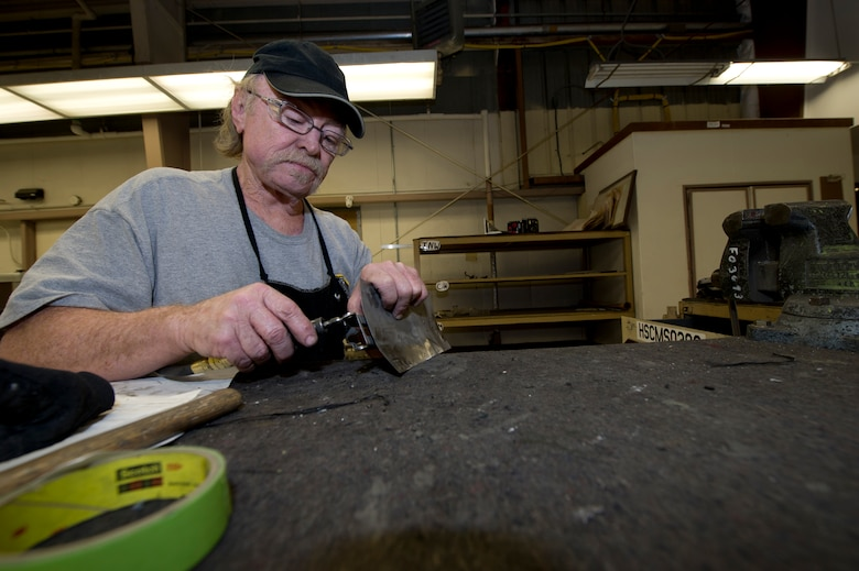 HOLLOMAN AIR FORCE BASE, N.M. – Larry Hilton, an aircraft sheet metal mechanic for the T-38 Talon, repairs an outer-engine leaf April 19. The outer-engine leaf is primarily responsible for deflecting exhaust from the engine. Hilton's maintenance of critical pieces such as the outer-engine leaf is fundamental in the T-38's ability to operate. (U.S. Air Force photo by Daniel E. Liddicoet/Released)