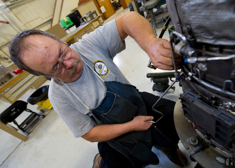 HOLLOMAN AIR FORCE BASE, N.M. – Bill Hyde, an aircraft engine mechanic for the T-38 Talon, re-builds a J85 jet engine April 19. The J85 is a small, single-shaft turbojet engine capable of producing up to 3,000 pounds of thrust. The engine is lightweight and cost-efficient, making it ideal for training at Holloman AFB. (U.S. Air Force photo by Daniel E. Liddicoet/Released)