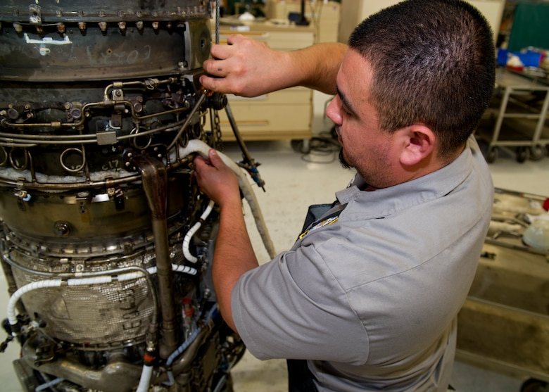 HOLLOMAN AIR FORCE BASE, N.M. – John Segovia, an aircraft engine mechanic for the T-38 Talon, tears down a J85 jet engine April 19. The J85 is one of the longest military jet engines in service with more than 16.5 million hours of operation.  It is still heavily relied on to complete the T-38's training mission at Holloman AFB. (U.S. Air Force photo by Daniel E. Liddicoet/Released)