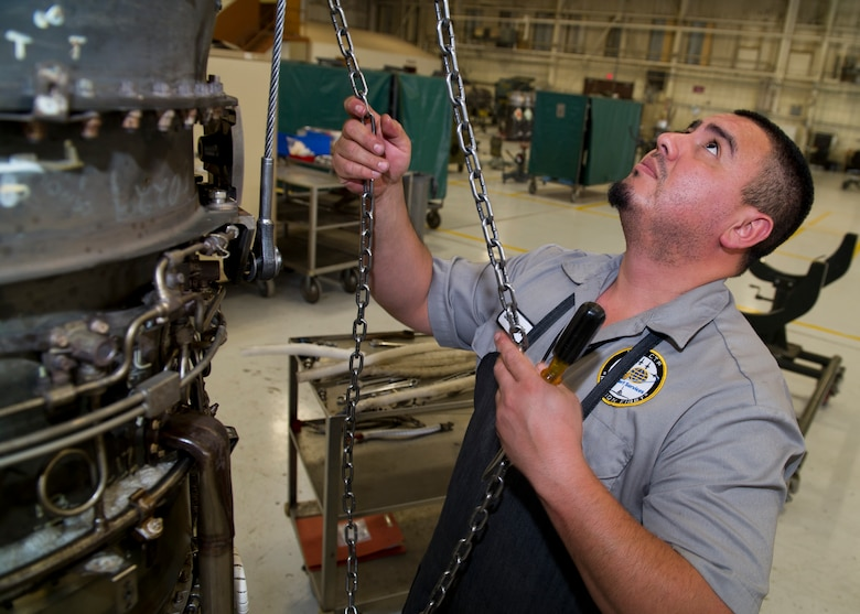 HOLLOMAN AIR FORCE BASE, N.M. – John Segovia, an aircraft engine mechanic for the T-38 Talon, tears down a J85 jet engine April 19. Mechanics tear down and re-build jet engines regularly as part of a maintenance routine to ensure the working order of every element within the engine.  (U.S. Air Force photo by Daniel E. Liddicoet/Released)