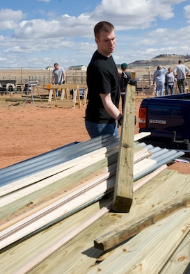 Airman 1st Class David Loving, 28th Civil Engineer Squadron structures apprentice, unloads building materials during the construction of a new temporary animal shelter at the Battle Mountain Humane Society in Hot Springs S.D., April 13, 2012.  Ten Airmen from Ellsworth Air Force Base, S.D, volunteered their time and energy to help build several new structures for the animals who lost their home in the fire. (U.S. Air Force photo by Airman 1st Class Anania Tekurio/Released)