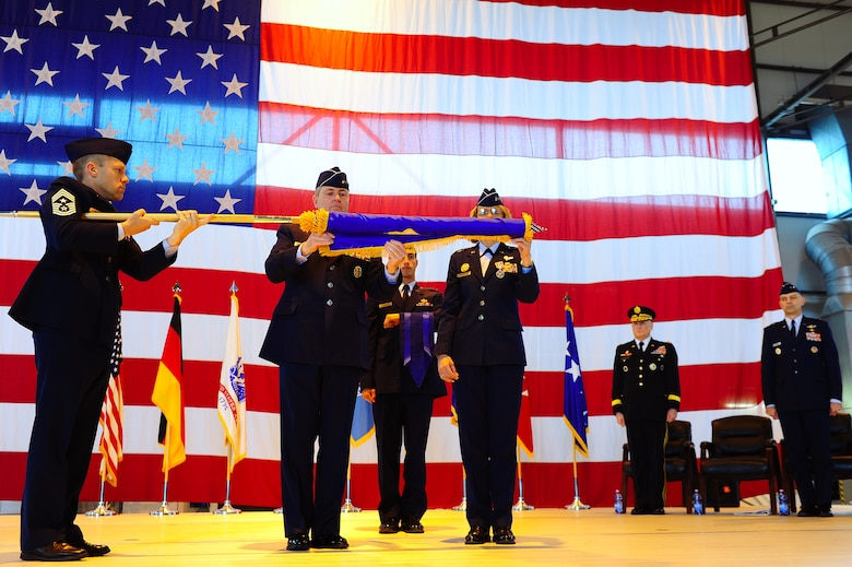 (Left to right) 17th Air Force Command Chief CMSgt Michael Grimm, U.S. Air Forces in Europe Commander Gen. Mark Welsh and 17th AF Commander Maj. Gen. Margaret Woodward furl and case the 17th AF flag during an inactivation ceremony here April 20. The unit, which served as the air component for U.S. Africa