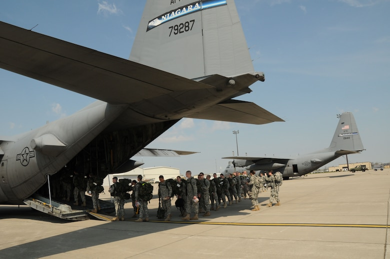 Canisius College Army ROTC Battalion Cadets march to the 107th Airlift Wing's C-130 aircraft for real world Army deployment training April 19, 2012 (U.S.Air Force Photo/Senior Master Sgt. Ray Lloyd)