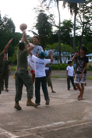 Filipino children from the Bahay Ni Nanay Orphanage play basketball with U.S. Marines and sailors on Antonio Bautista Air Base in Puerto Princesa, April 21, 2012. The children and service members spent several hours together getting to know one another. The service members are currently here for the duration of Balikatan 2012 and are part of Task Force Palawan. BK12 is a bilateral, joint exercise conducted annually between the U.S. and the Republic of the Philippines. This year marks the 28th iteration of the nations' exercise.
