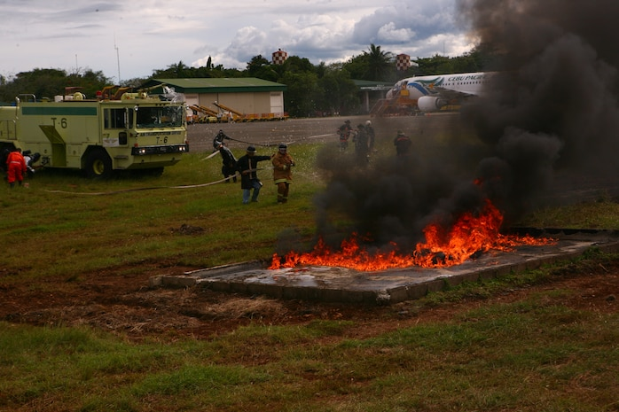 A Puerto Princesa Airport  Aircraft Rescue and Firefighting team, along with a U.S. Marine ARFF team, put out a training fire on the PPA flight line in Puerto Princesa, Palawan, Republic of the Philippines April 22, 2012. The fire fighters trained together with U.S. Marines in support of Balikatan 2012  Task Force Palawan. BK12, in its 28th iteration, is a bilateral, joint exercise conducted annually between the Republic of the Philippines and U.S. military members. The U.S. Marines are with Aviation Operations Company, Marine Wing Support Squadron 172, Marine Wing Support Group 17, 1st Marine Aircraft Wing, III Marine Expeditionary Force.